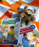 am_Kindertisch_wird_gelesen_und_gemalt_Teddy_hat_schon_ein_Pflaster